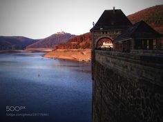 Dam of Eder lake by Bilderreisen from http://500px.com/photo/201776961 - The Edersee also known as Ederstausee is 11.8 km of water surface and with 199.3 million m of space the second and third largest reservoir in Germany and is located at the Fulda-Zufluss Eder behind the 48 m high Staumauer The Edertalsperre at the core town of Waldeck in the district of Waldeck-Frankenberg (North Hesse).. More on dokonow.com.