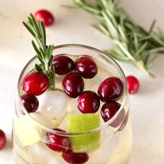 Christmas Sangria With Pinot Grigio, Apple Cider, Sugar, Cranberries, Cranberries, Granny Smith Apples, Rosemary Sprigs
