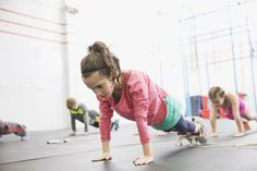 Kids doing planks in a gym