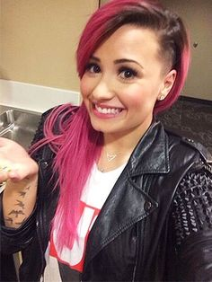 Demi Lovato's new pink, shaved hair for her Neon Lights Tour. Love it!