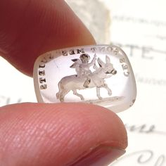 """Antique glass Tassie gem seal in French.  Shows a cupid on a donkey (ass) with the motto """"Such are my subjects"""" meaning love can make an ass out of anyone."""