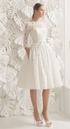 Adorable tea-length wedding dress with flower lace design and quarter length sleeves; Featured Dress: Rosa Clara