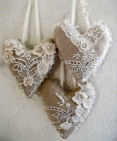 Could use white embroidered fabric and make these, then embellish with ribbon, pearls, etc.