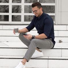 genuine trousers with white leather shoes and a solid shirt untucked.