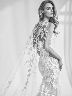 Who said Capes were just for super heroes? | Atelier Pronovias 2018 Collection | Follow @WedLuxe for more wedding inspiration! #cape #wedding #weddingdress #lacecape #capedress #queen #bride #pronovias #pronoviasweddingdress