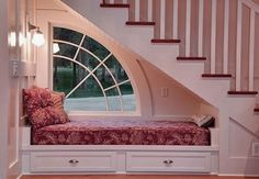 Awesome Under the Staircase Reading Nook - Love the Wedge Window!