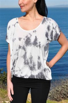 Su Tie Dye Tunic Top Yoga Tee Shirt in White by Jala. A beautiful statement piece that will compliment any outfit! Can be worn gathered at the waist or long and flowy. $53.95 at www.karmicfit.com #yoga #yogatshirts #yogatees