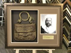 A custom shadow box is a great way to display and preserve a family heirloom. #customframing #shadowbox #heirloom #satchel #familymemories  For more information please visit www.eraframes.com