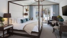 Suite Escape Alexandria Abramian JULY 01, 2014 In one of the bungalow's two guest bedrooms, Mitchell Gold + Bob Williams's four-poster Banks metal bed complements Berman's Venice writing table and Troy Lighting's Pike Place pendant with subtle nautical rope detailing.