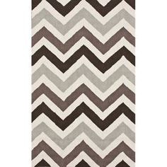 Hand-hooked wool rug with a chevron motif.   Product: Rug    Construction Material: 100% Wool Color: Earth    Features: Hand-hooked     Note: Please be aware that actual colors may vary from those shown on your screen. Accent rugs may also not show the entire pattern that the corresponding area rugs have.  Cleaning and Care: These rugs can be spot treated with a mild detergent and water.  Professional cleaning is recommended if necessary.