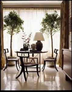 earth tones plus use of plants  makes me wonder if we can remove the blinds and get ethereal curtains instead