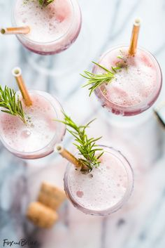 Rosé Raspberry Sorbet Mimosas are a fun cocktail for Mother's Day, bridal showers, brunch or just a girls get together.  These girly cocktails are so easy to make and everyone will love them!