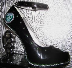 black platform heels with silver brass knuckle by STEAMHATTER, $125.00