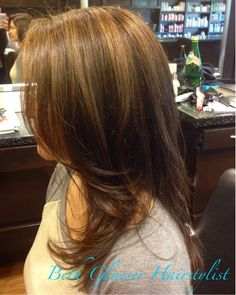 By Beth Glaeser Hairstylist. Soft highlights add dimension and glow to a warm brown base color. Add smoothing cream to the ends of hair and blow out with a large, boar bristle round brush for maximum smoothness and volume. Tip: dry hair 70-80% with a simple vent brush before finishing with a round brush. #highlights #brunette #blowout