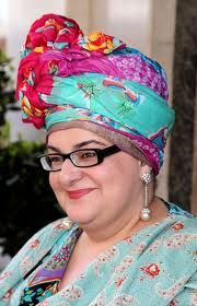 "Camila Batmanghelidjh, founder of the Kids Company, is a truly inspirational woman. A vibrant, passionate woman, who fights tirelessly to raise funds for her charities, she has also been described as ""Britain's most colourful charity leader"" and is well known for her eccentric and flamboyant dress sense. The Kids Company provide emotional and educational support to vulnerable inner-city children."