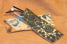 Easy glasses case sewing tutorial. She promises it's just a 15 minute job -- very appealing!