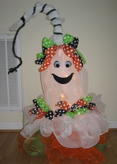 Ginger the Ghost is all dressed and ready for Halloween.  I made her using deco mesh and a tomato cage.