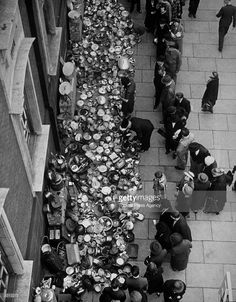 A huge collection of aluminium pots and pans outside a London town hall - bound for Aircraft Assembly Presses all over England to make essential parts for RAF machines.