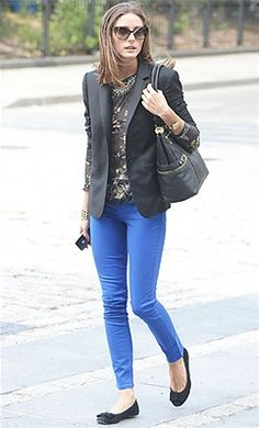 Olivia Palermo mixed her bright blue bottoms with a black blazer, printed blouse, and bow-topped ballet flats.
