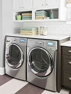 Side-by-side front loading washer and dryer with countertop and open shelving
