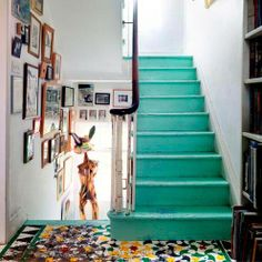 Hallway with green stairs and tiled floor
