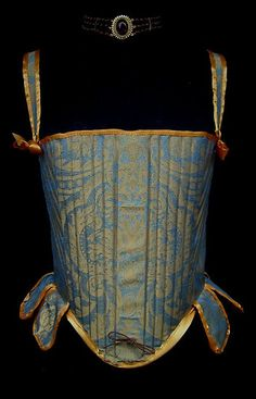 16th Century Corset. This is an example of copying a period item but not understanding how it was engineered and why. The tabs on corsets were not, as these are, decorative. They help distribute the pressure of the corset off the hips and should be boned.