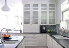 The 25 Most Gorgeous White Kitchen Designs For 2016 - Black countertops work wonderfully in white kitchen designs. Check out how this example ties the black countertops into the rest of the space with the greyish-green tile backsplash White Kitchen Cabinet Doors, Types Of Kitchen Cabinets, Kitchen Cabinets Pictures, Glass Kitchen Cabinets, Glass Cabinet Doors, Kitchen Countertops, White Cabinets, Glass Doors, Gloss Kitchen