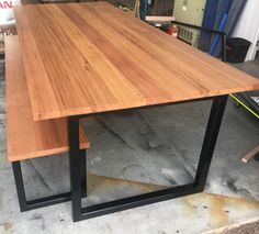 Recycled Tasmanian Oak Industrial Dining Table With Black Metal Legs and bench seat