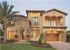 ✔stucco and decorative masonry exterior, roof tiles to resemble terra cotta tile