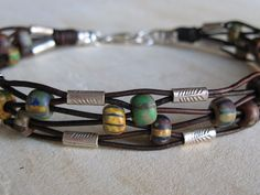 Rustic Woven Leather Bracelet. Neat Etsy board!
