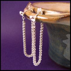 "Sterling Silver ""fluid hoop"" chainmaille earrings, JPL3 weave, by Red Panda Chainmaille. $85."