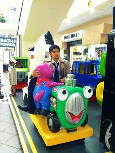 """Osric dressed as Cas riding a kiddie car for GISHWHES - """"There was something you always wanted to do as a child but never did. Do it."""""""