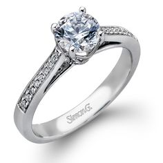 Classy Collection - This gorgeous 18K white gold ring is comprised of .09ctw round white Diamonds. - MR2278