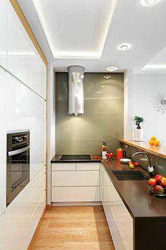 W aneksIe kuchennym  szafki zrobiono z takich samych materiałów, co meble w salonie izdecydowano się na identyczną kolorystykę. Nie m...
