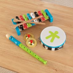 Let the music begin! Our Lil Symphony Band in a Box puts four fun musical instruments into one convenient package. It's an amazing deal that the young rock stars in your life are sure to love. Features include: 2 cymbals 1 recorder  1 tambourine  1 xylophone