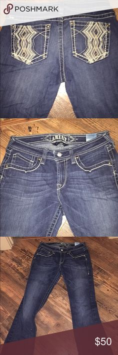 Ariat Jeans Lightly worn, have a small hole on the bottom right leg. Ariat Jeans Boot Cut