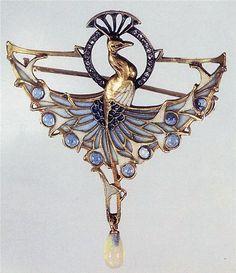 Lucien Gautrait: an opal, diamond, plique-à-jour enamel, and gold peacock brooch.