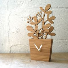 This just tops it off how arson now this I want...you can put it as a center piece for kitchen table and have flowers plus keep your eye on the clock ago you get to work on time Houseplant Desktop Clock Medium by decoylab on Etsy, $68.00