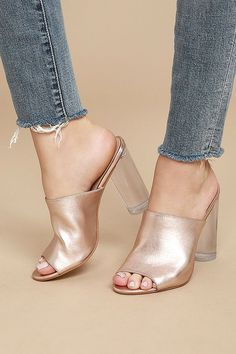 Even Cinderella would be envious of the Steve Madden Classics Rose Gold Leather Lucite Mules! Shimmering rose gold leather is molded to a peep-toe upper, and slide-on silhouette. Clear, lucite heel is totally glam!