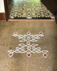 Karthigai Day 10 :) Day View :) Take a simple Kolam and just mirror it. Use your imagination to convert a few dots to vallakus and tadaaaa ! Festive it is :) Life is beautiful if we choose for it to be ☺️ Indian Rangoli Designs, Rangoli Designs Flower, Henna Art Designs, Rangoli Border Designs, Small Rangoli Design, Rangoli Designs Images, Rangoli Designs With Dots, Beautiful Rangoli Designs, Rangoli Borders