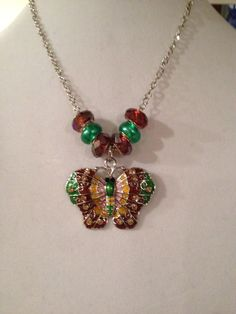 A personal favorite from my Etsy shop https://www.etsy.com/listing/220565649/brown-beauty-butterfly-necklace