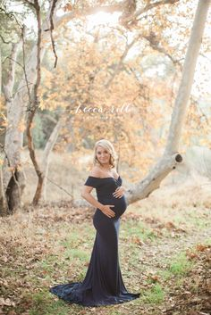 This mama is stunning in our Audrey gown in navy | Fitted off the shoulder short sleeve maternity gown | Handmade in Utah by Sew Trendy | Photo by Becca Rillo Photography