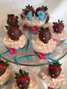 Strawberry cupcakes packaged in clear cups with ribbon accents