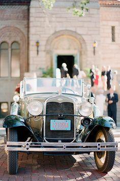 A vintage Model A getaway car for the ceremony | @lauraivanova | Brides.com