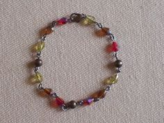 bicone crystals warm fall colors with bronze metal beads. Individual links bracelet