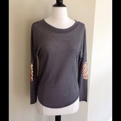 NEW! Grey Top with Sequins - SALE! Purchased online. This is brand new. Grey its gold sequins on elbow area. Thinner material, you may want to wear a tank top or Cami underneath. Size medium bit fits smaller. I'd say this would work for small and even XS sizes. No material tag attached, that's how it arrived to me. Tops