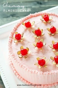 Cherry Almond Cake >> by Tastes of Lizzy T's.Light, airy from-scratch maraschino cherry cakes with pink almond and cherry flavored buttercream. Top this cherry almond cake with simple little made from almonds and cherries. Cake for kid Cherry And Almond Cake, Cherry Cake, Almond Cakes, Cherry Frosting, Whipped Frosting, Whipped Cream, Cherry Desserts, Just Desserts, Delicious Desserts