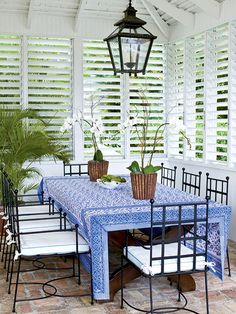 Dress windows with shutters for an easy, tropical style and low-maintenance appeal. - shutters instead of blinds faster to open close every day. Beautiful white shutters give this patio area the feel of the tropics. Budget Blinds of Benton Style Tropical, Tropical Home Decor, Tropical Houses, Coastal Style, Tropical Windows, Southern Style, Outdoor Rooms, Outdoor Living, Outdoor Furniture Sets