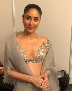 On your wedding day, it's possible to go sheer without baring too much skin. Actor Kareena Kapoor pulled this of flawlessly in a Manish Malhotra lehenga as the designer's showstopper at his Singapore fashion show on Sunday. Bollywood Actress Hot Photos, Indian Actress Hot Pics, Indian Bollywood Actress, Bollywood Girls, Beautiful Bollywood Actress, Bollywood Saree, Beautiful Indian Actress, Bollywood Fashion, Beautiful Actresses