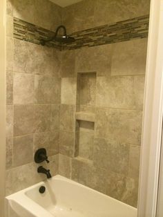 Very nice tile shower and tub surround by Bob & Pete's Floors, Canton, OH. (330) 478-0576 www.bobandpetesfloors.com https://www.facebook.com/pages/Bob-and-Petes-Floors/454860385715